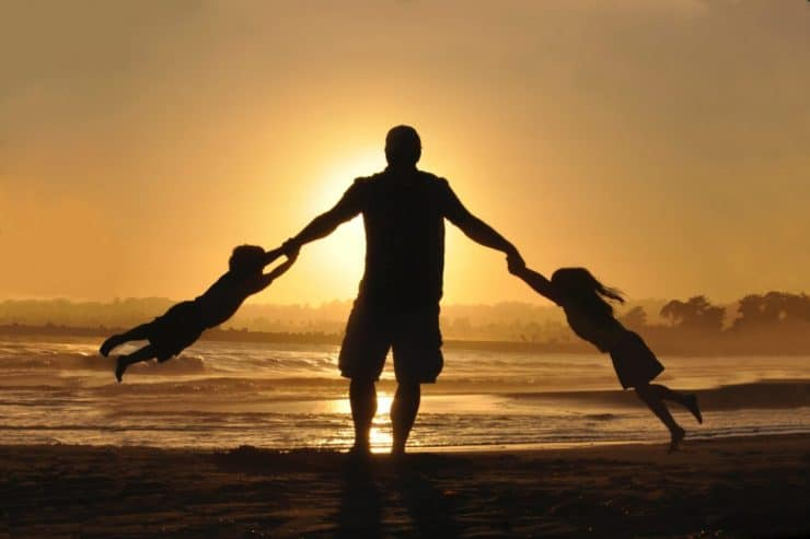 silhouette of dad with 2 children