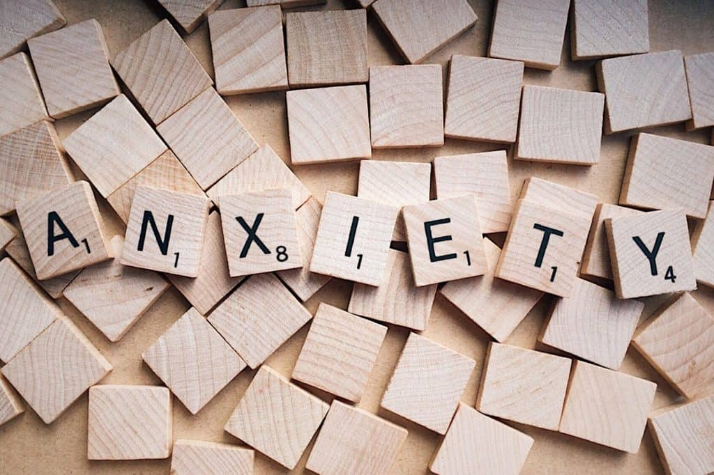 wooden letters that spell anxiety