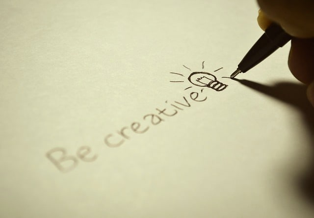 "handwritten ""be creative"" with a drawn lightbulb"