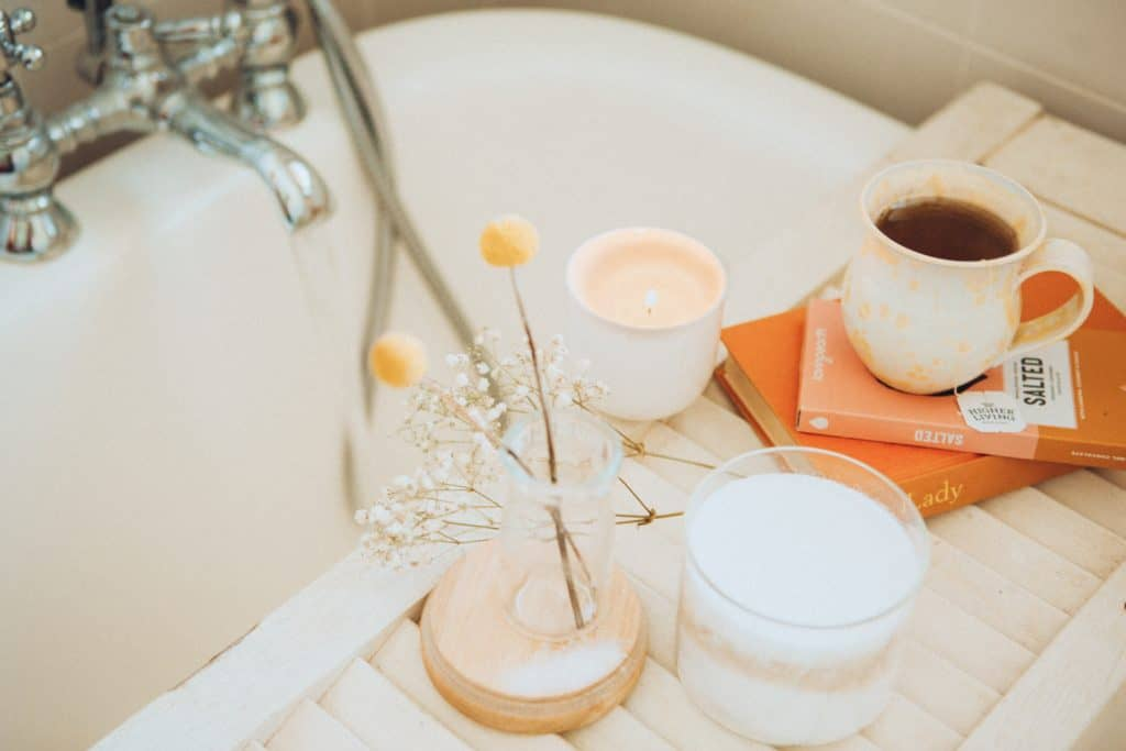 bathtub-with-candle-books-and-tea