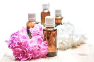 essential-oils-next-to-pink-flowers