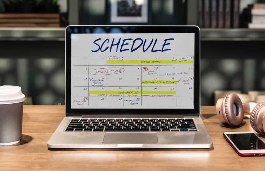 laptop with digital schedule calendar