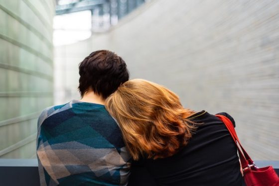 Person laying on another persons shoulder - How To Help Someone With Anxiety